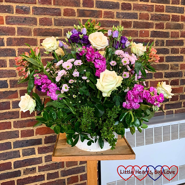 A flower arrangement of pink and purple flowers