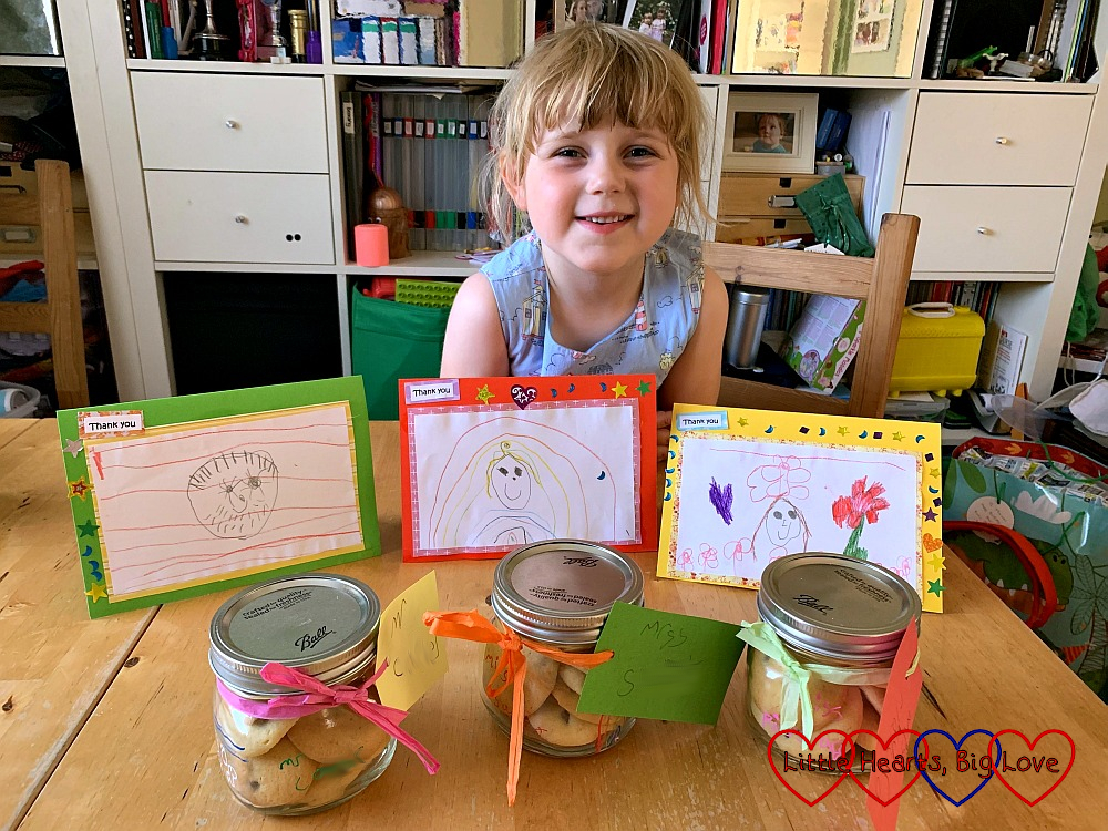 Sophie with her cards and jars of home-made biscuits for the teachers