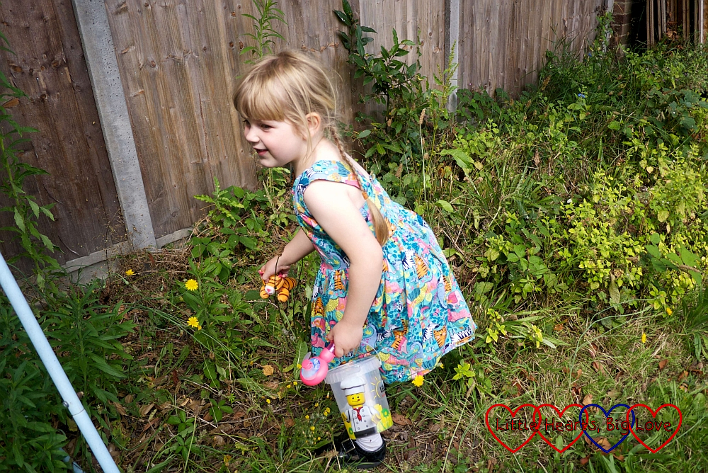 Sophie looking for animals hidden in the garden