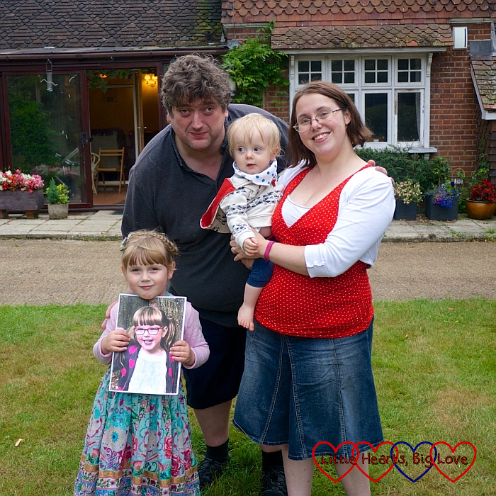 Me (holding Thomas), hubby and Sophie (holding Jessica's picture) in Grandma and Grandad's garden at Thomas's birthday party