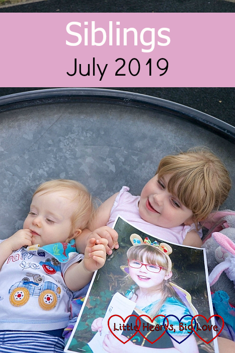 """Thomas and Sophie holding a picture of Jessica in a spinning saucer - """"Siblings - July 2019"""""""