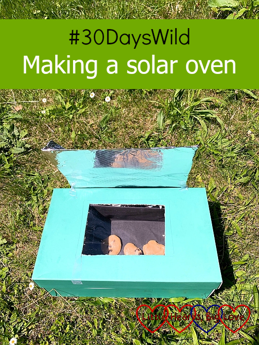 "The solar oven in the garden with cookie dough inside - ""#30DaysWild - Making a solar oven"""
