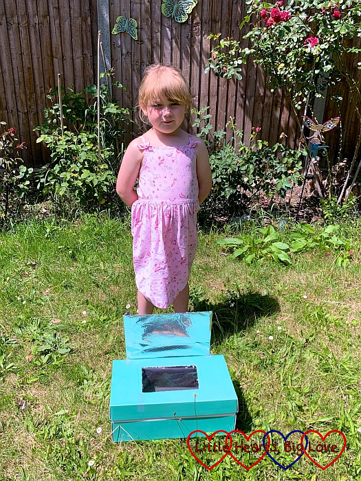 Sophie with her solar oven in the garden