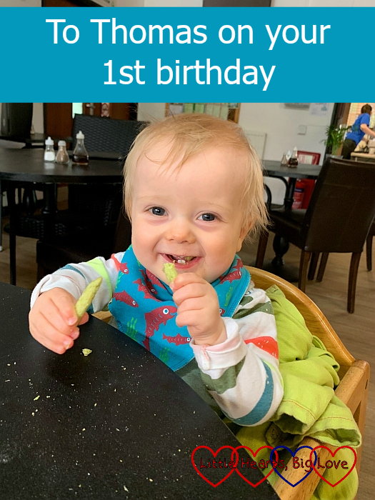 "Thomas sitting in a highchair eating some baby snacks - ""To Thomas on your 1st birthday"""
