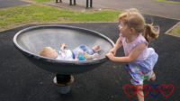 Sophie spinning Thomas in the spinning saucer