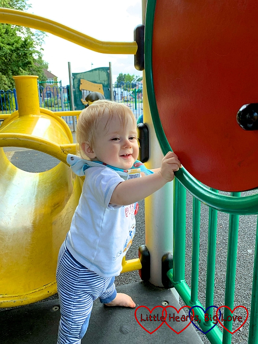 Thomas spinning a disc on the toddler play area