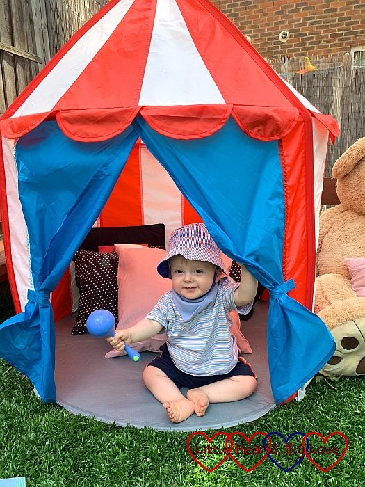 Thomas sitting in the pop-up circus tent in the Halo garden
