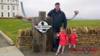 Hubby with Jessica and Sophie at the End to Enders sign at John O'Groats