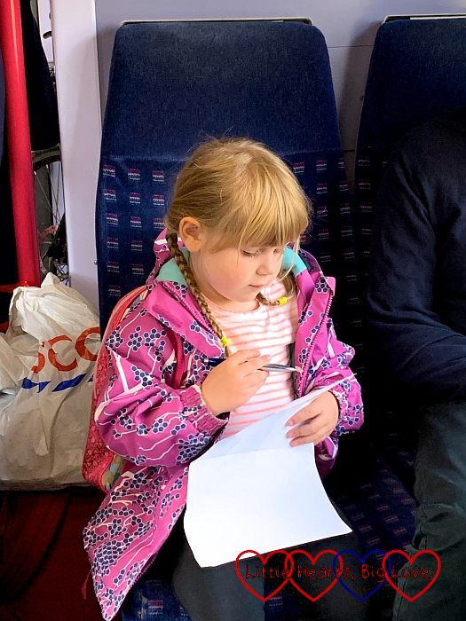 Sophie ticking stations off her list on the train