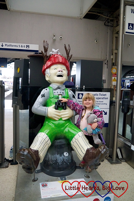 Sophie with the 'Well here we are' Oor Wullie sculpture at Inverness station
