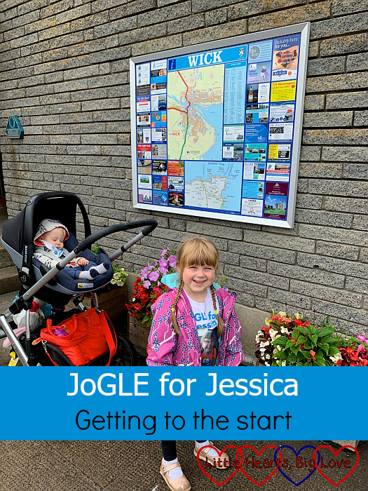 "Sophie in front of a town map of Wick - ""JoGLE for Jessica - Getting to the start"""