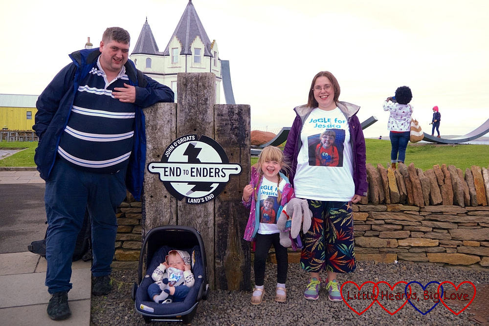 "Me, hubby, Sophie and Thomas by the ""End to Enders"" sign at John O'Groats"