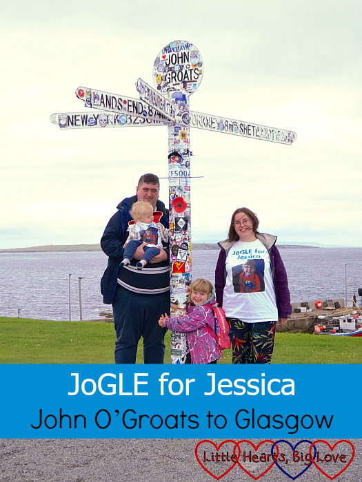 "Me, hubby, Sophie and Thomas wearing over ""JoGLE for Jessica"" T-shirts at the John O'Groats signpost - ""JoGLE for Jessica - John O'Groats to Glasgow"""