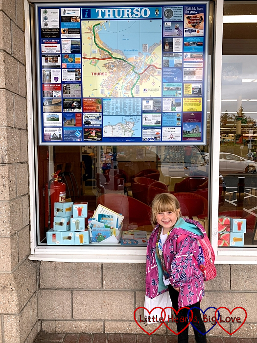 Sophie standing in front of a street map of Thurso