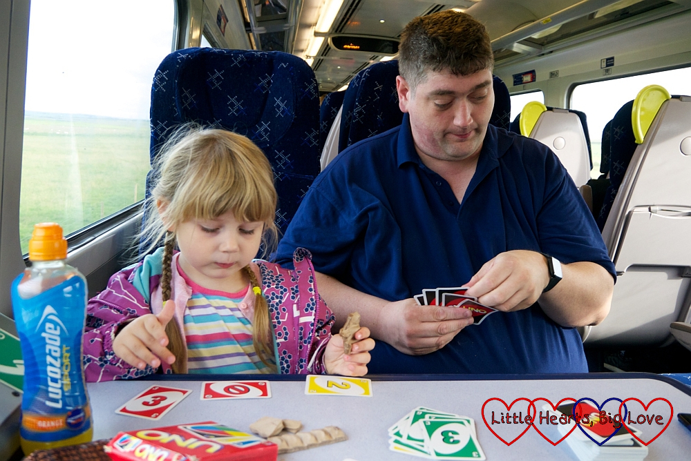 Hubby and Sophie playing UNO on the train