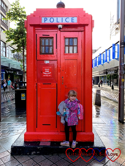 Sophie standing in front of a red police box in Glasgow