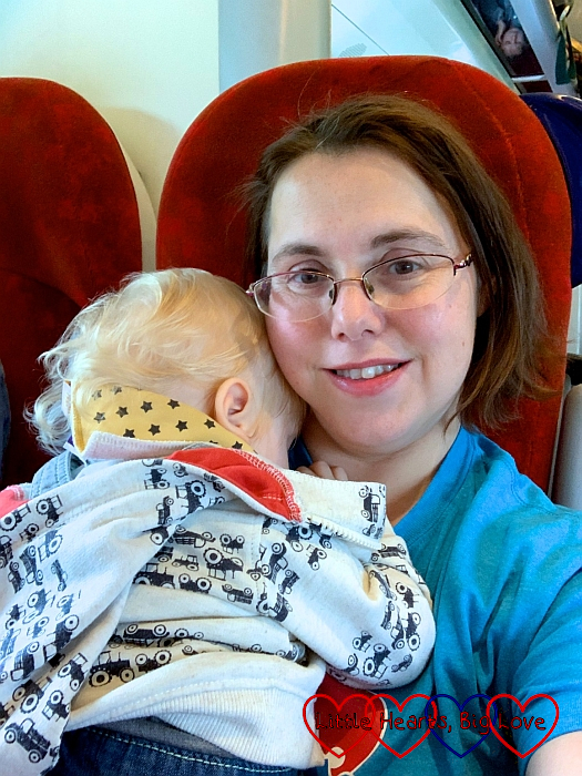 Me on the train holding a sleeping Thomas