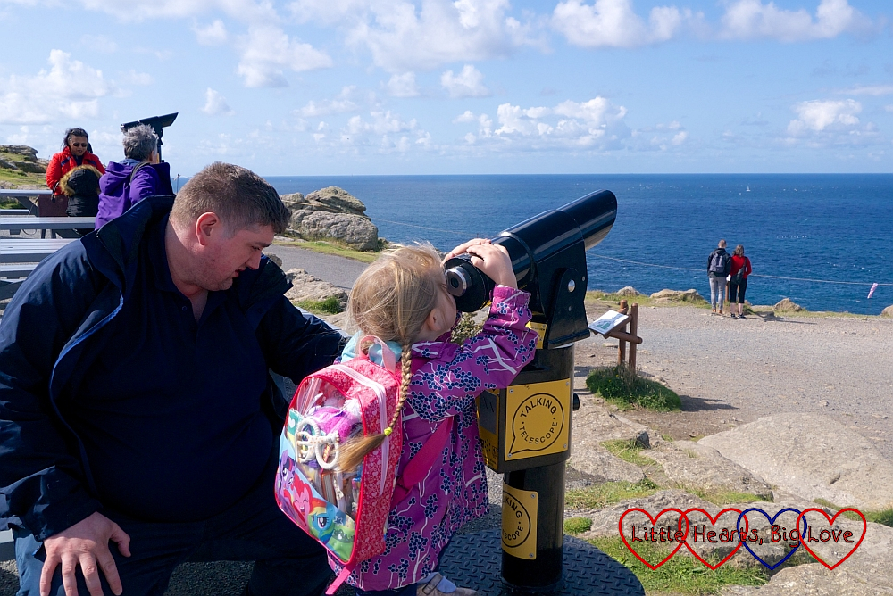 Hubby with Sophie (looking through the telescope) at Land's End