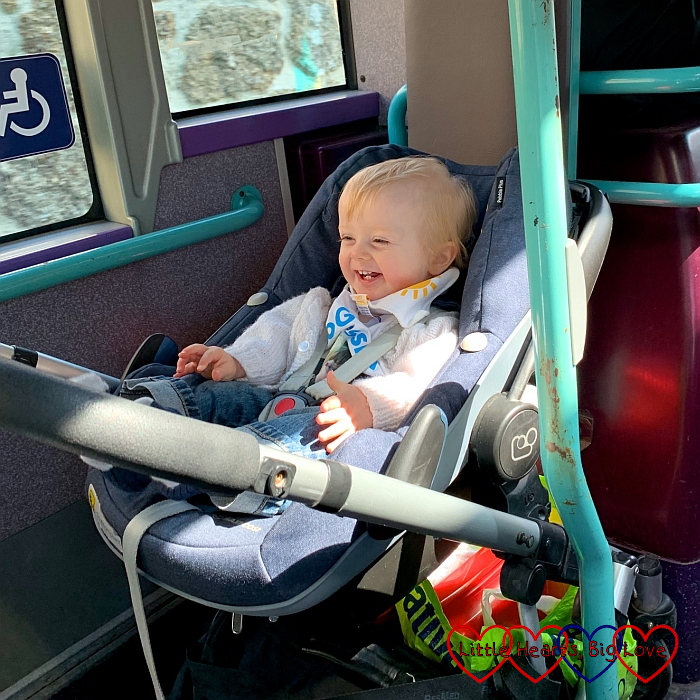 A very smiley Thomas on the bus heading back from Land's End