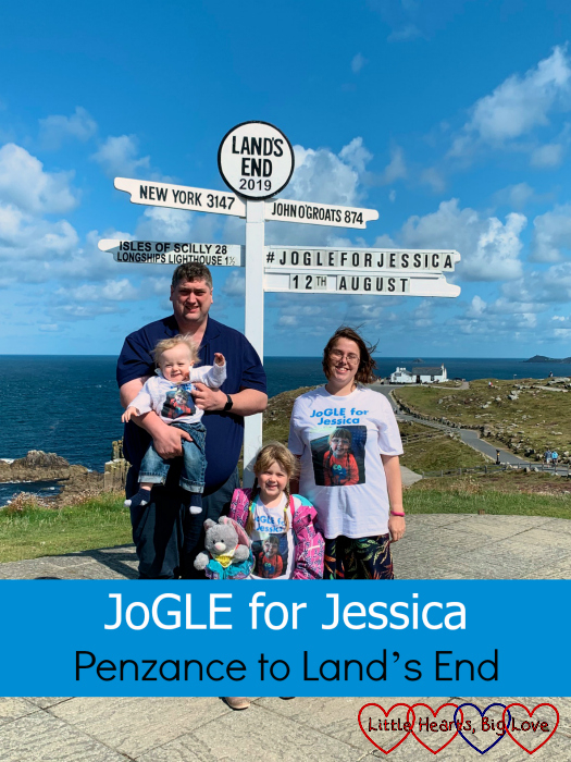 "Me, hubby, Sophie and Thomas wearing our ""JoGLE for Jessica"" T-shirts at the Land's End signpost with ""JoGLE for Jessica 12th August"" added to the signpost - ""JoGLE for Jessica - Penzance to Land's End"""