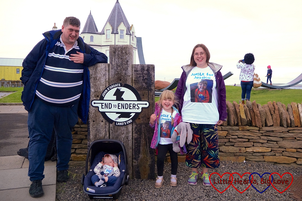 Hubby, Thomas, Sophie and me (wearing our JoGLE for Jessica T-shirts) at the End-to-Enders sign at John O'Groats