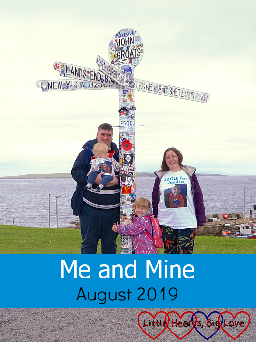 "Hubby, Thomas, Sophie and me (wearing our JoGLE for Jessica T-shirts) at the John O'Groats signpost - ""Me and Mine - August 2019"""