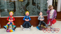 Sophie with three Wee Oor Wullies in Princes Square- Patch, Our Wullie and K C Potter