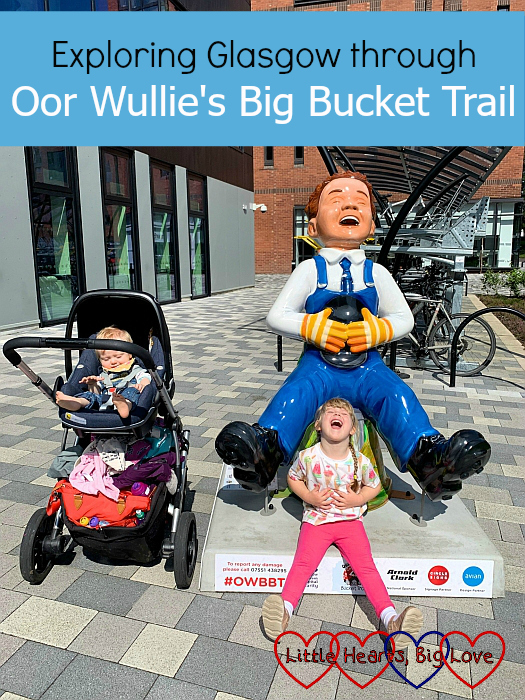Thomas and Sophie with the 'Take a Ride' Oor Wullie sculpture with Sophie copying the pose