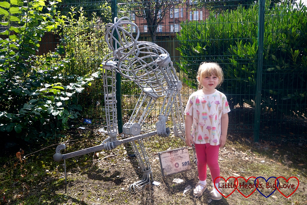 Sophie with the metal hockey player sculpture from the 2014 Commonwealth Games