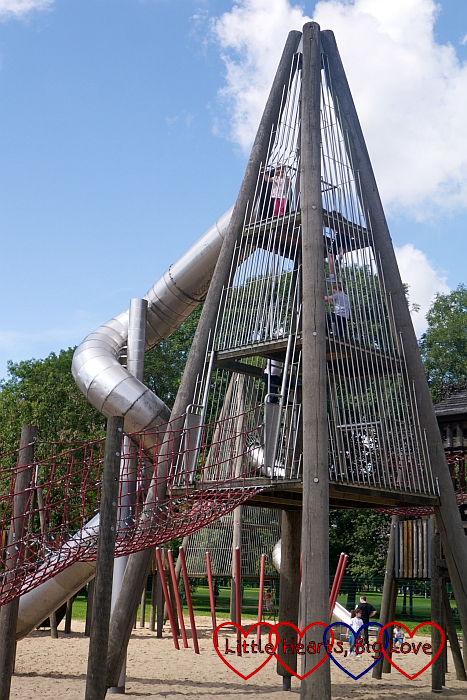 Sophie at the top of the pyramid climbing frame about to go down one of the tunnel slides