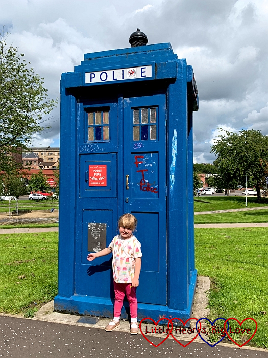 Sophie standing outside a blue police box