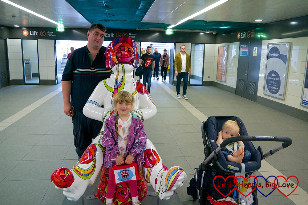 Hubby, Sophie and Thomas with the 'Charles Rennie' Oor Wullie sculpture in St Enoch subway