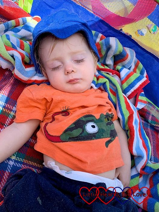 Thomas asleep on a beach towel