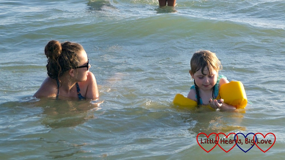 Sophie and her cousin swimming in the sea