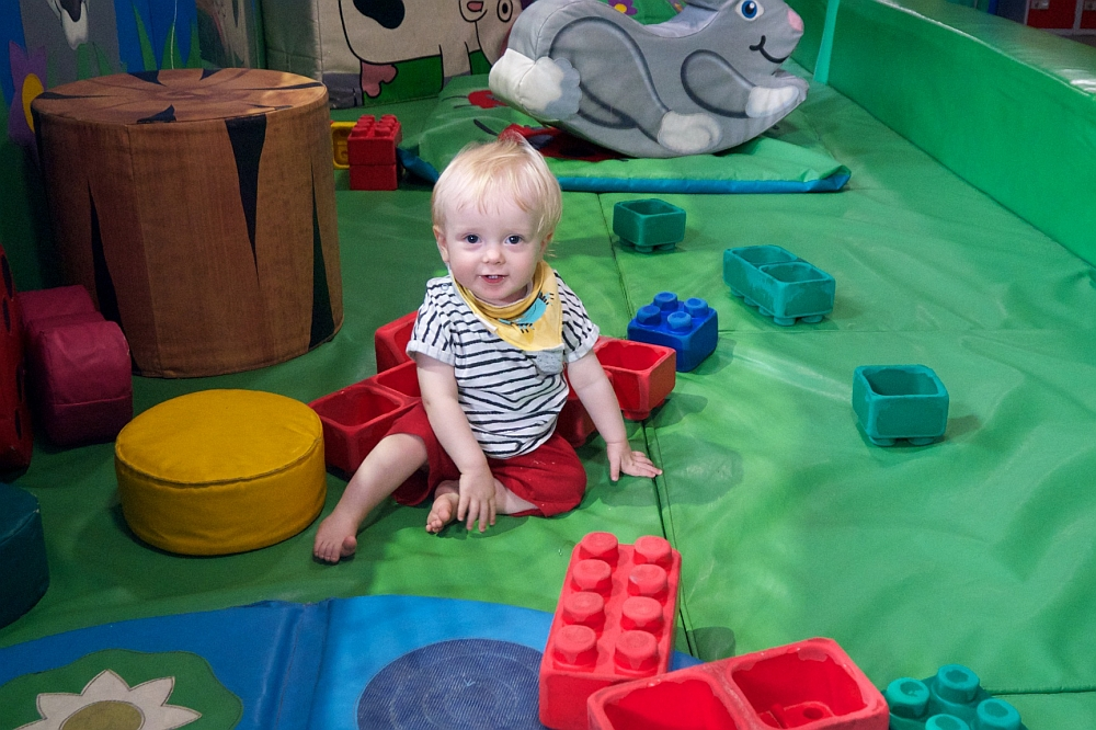 Thomas sitting in the soft play area