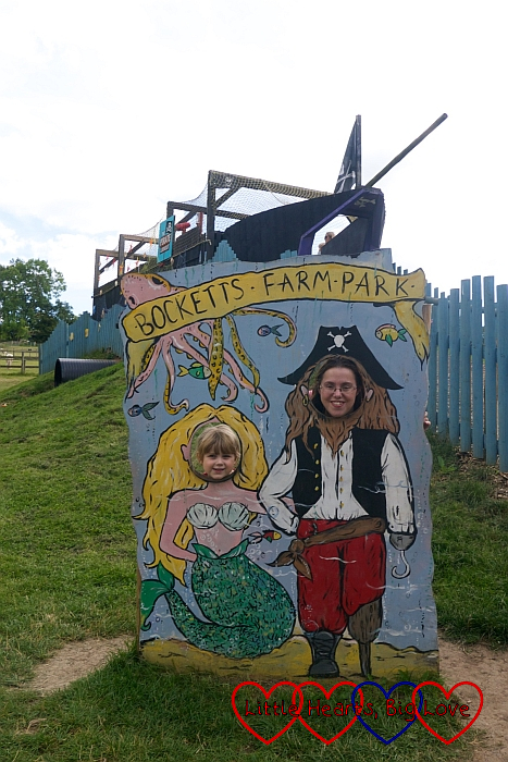 "Me and Sophie with our heads through the picture board showing us as a pirate and mermaid with ""Bocketts Farm Park"" written above our heads"