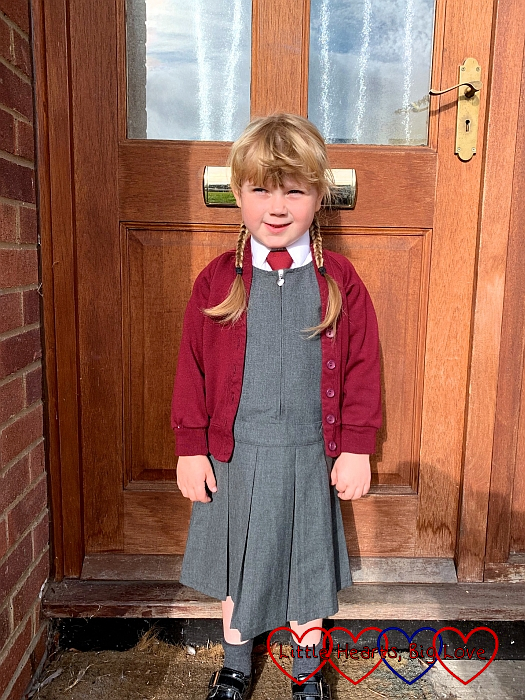 Sophie outside the door ready for her first day of Year 1