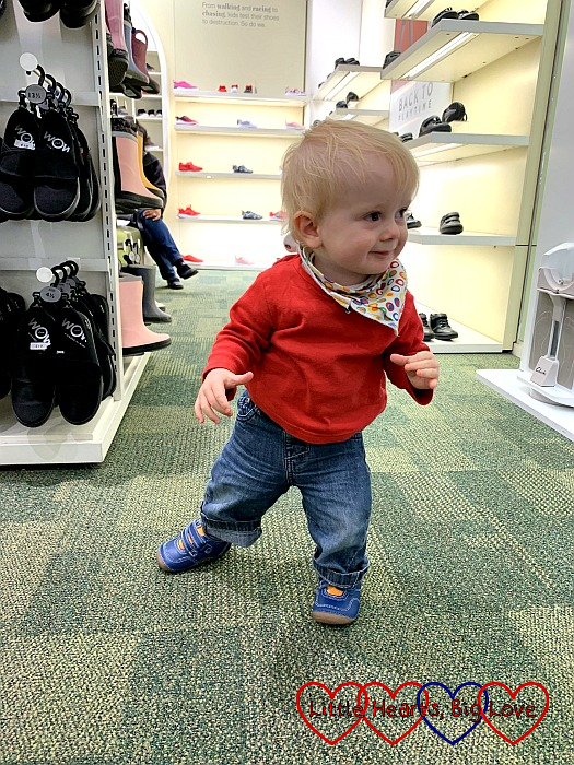 Thomas standing in the shoe shop wearing his new shoes
