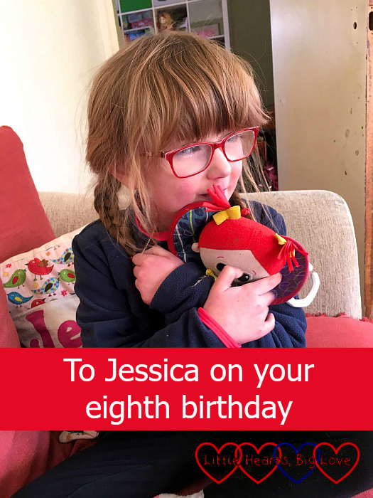 "Jessica sitting on the sofa, hugging her Kerry doll - ""To Jessica on your eighth birthday"""