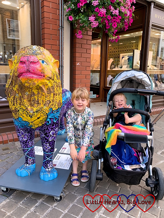 Sophie and Thomas with the 'Diamond Empress' lion sculpture in Windsor