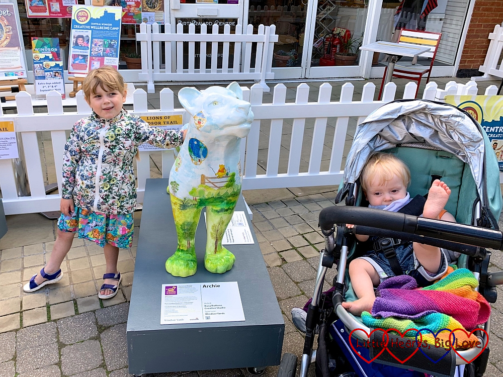 Sophie and Thomas with the 'Archie' lion sculpture in Windsor