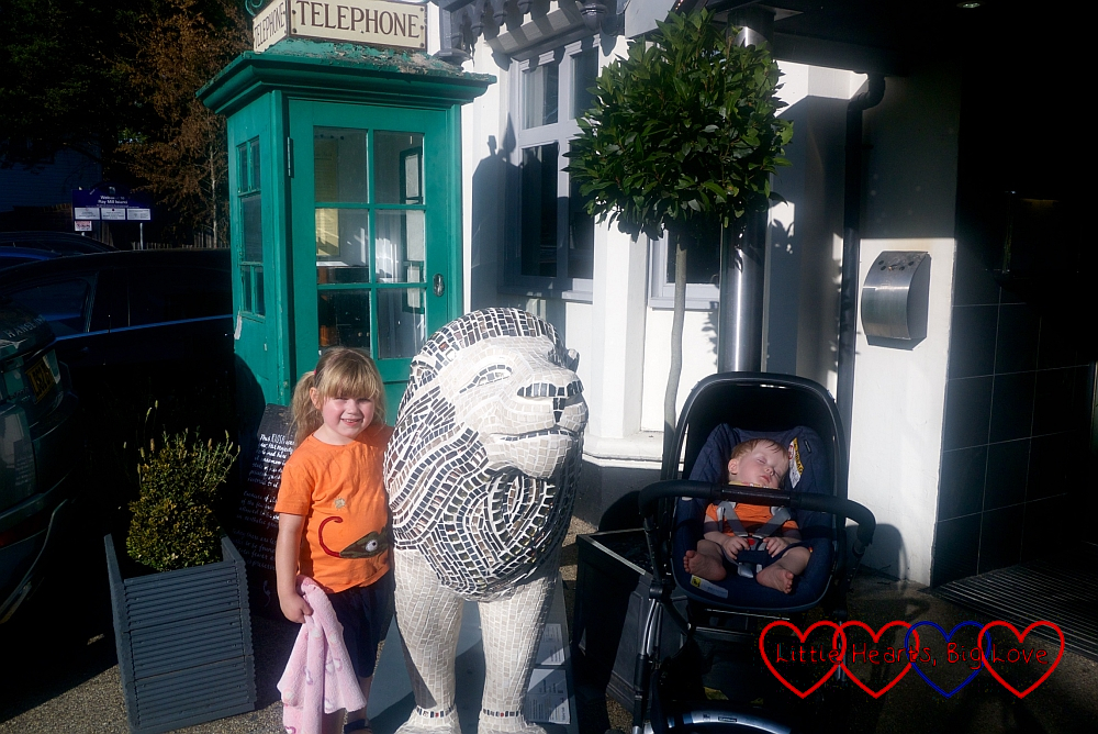 Sophie and Thomas with the 'Circle of Life' lion sculpture at Boulters Lock