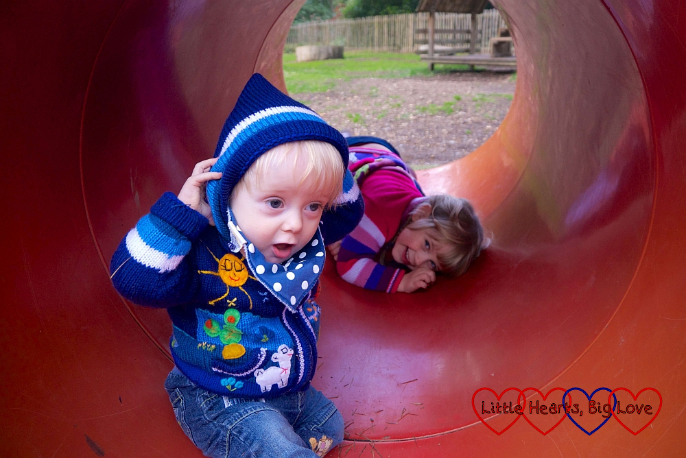 Sophie and Thomas inside the tunnel in the play area