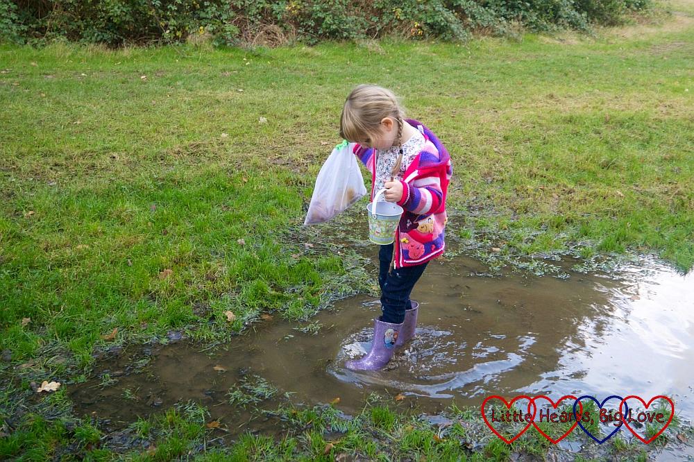 Sophie walking through a big puddle