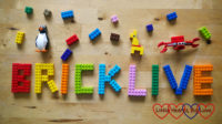 The word 'BRICKLIVE' created using colourful LEGO bricks surrounded by brick figures and small bricks