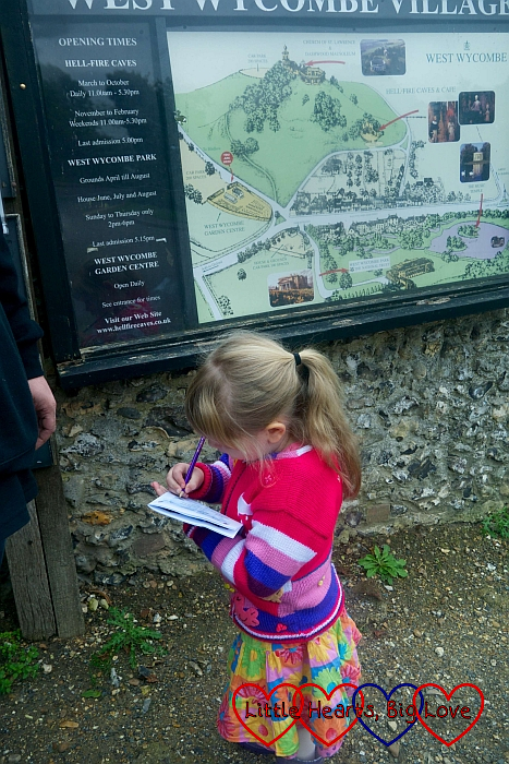 Sophie ticking off an answer on her trail sheet at West Wycombe village
