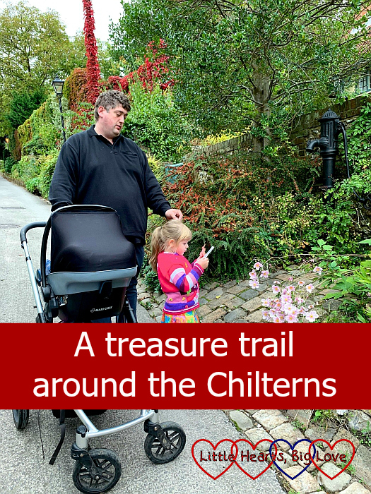 "Sophie and hubby walking down a leafy lane with Sophie ticking off an answer on her trail sheet - ""A treasure trail around the Chilterns"""