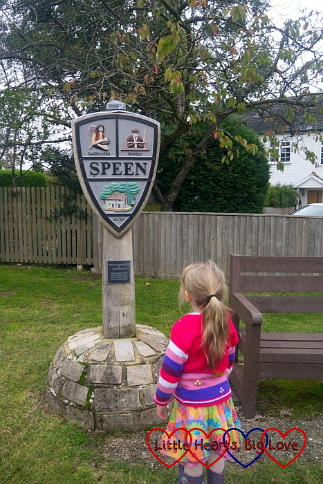 Sophie in front of the Speen village sign