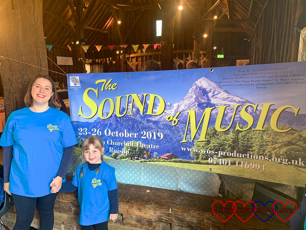Me and Sophie in front of the banner for The Sound of Music