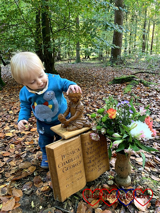 Thomas looking at the sculpture of Jessica on the memorial at her forever bed